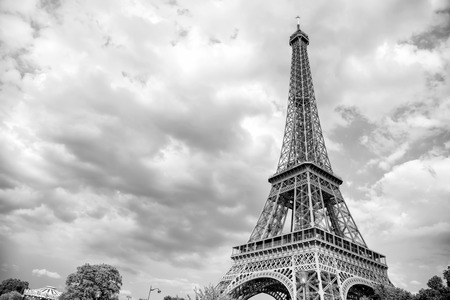 Eiffel Tower at sunset in Paris, France. Romantic travel background. Eiffel tower is traditional symbol of paris and love. Stok Fotoğraf