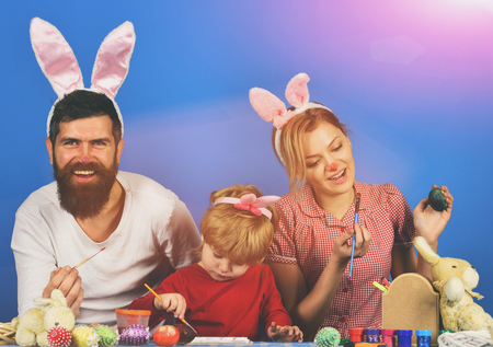 easter egg. funny holiday bunny rabbit and eggs Man, woman and kid wearing bunny ears. Holiday spirit and joy concept. Stock Photo