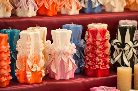 Candles on shelf in decoration shop. Decor, design, craft, decoration shop. Wick, paraffin or wax od various colors, decor. Sale, shop, shopping.