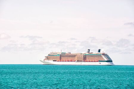 Great Stirrup Cay, Bahamas - January 08, 2016: cruise ship in blue sea on white sky. Water transport, vessel, transportation. Vacation, wanderlust, travel. Adventure, discovery, journey.