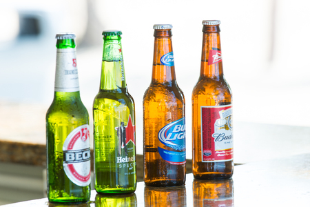 Great stirrup cay, Bahamas - January 08, 2016: beer in glass bottles on bar counter. Alcohol, bad habits. Refreshment, drink, beverage. Beer party, celebration.