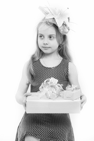 Boxing day concept. Child hold gift box isolated on white. Birthday, anniversary celebration. Holiday present and surprise. Girl with flower in long blond hair.