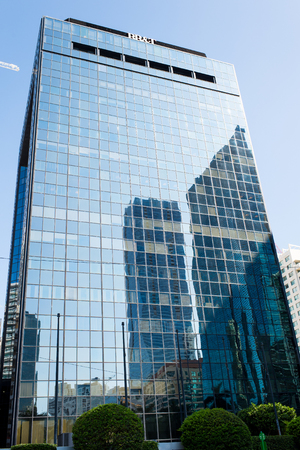 Miami, USA - October 30, 2015: skyscraper building with glass facade on blue sky. Architecture and design. Commercial property or real estate. Success and future concept. Editorial