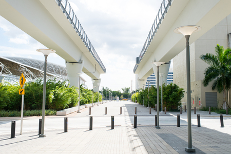 Viaduct structures in downtown district of miami, usa. Overpass or bridge railway road on sunny outdoor. Structure and construction design. Metrorail system and transportation.