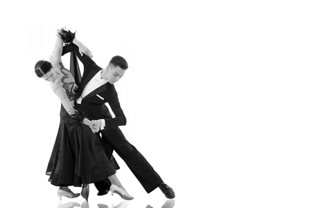 ballroom dance couple in a dance pose isolated on white background. ballroom sensual proffessional dancers dancing walz, tango, slowfox and quickstep black and white