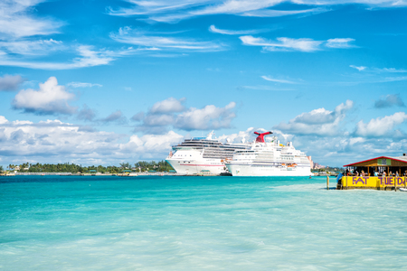 Nassau, Bahamas - January 07, 2016: cruise ships in port. Ocean liners in Caribbean sea on sunny blue sky. Summer vacation on tropical island. Travelling by water. Wanderlust adventure and discovery.