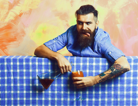 Brutal caucasian hipster with alcohol cocktail and flask Stock Photo