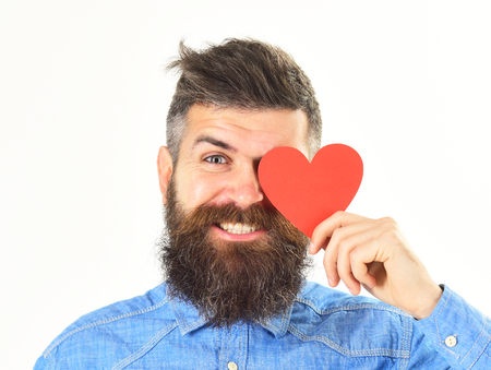 Man with beard with happy face holds red heart