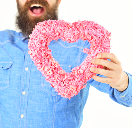 Pink heart in male hands. Stock Photo