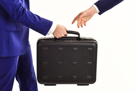 Male hand carry briefcase for exchange. Handover of case Reklamní fotografie