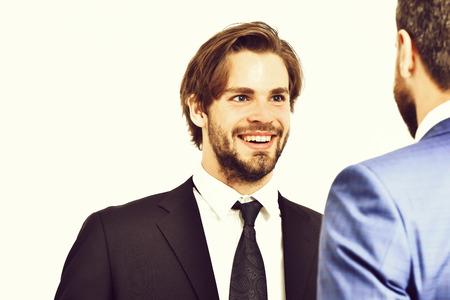 happy men in jacket speaking with businessman 스톡 콘텐츠
