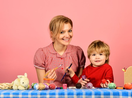 Family prepares for holiday on pink background Stock Photo - 101655262