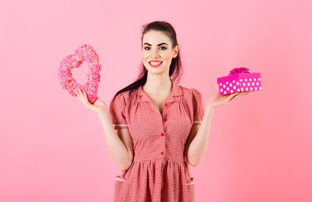 Shopping and presents concept. Happy girl holds gifts after holiday shopping Stock Photo