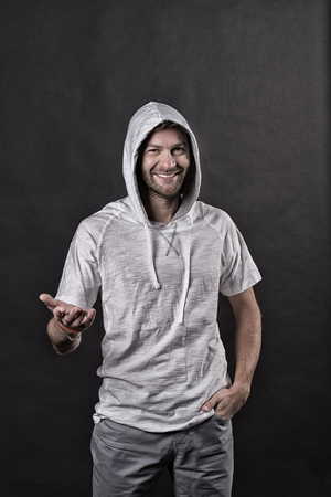Fashion model smile in hoodie tshirt. Happy man with beard in hood. Bearded man wear casual sweatshirt. Active lifestyle and health activity. Fashion style and trend concept, vintage filter