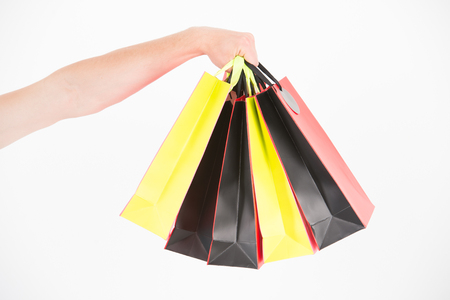 Male hand holds five shopping bags. Shopping concept. Hand holds bunch of colorful shopping bags. Shopping on black friday. Client bought lot items with discount Banque d'images