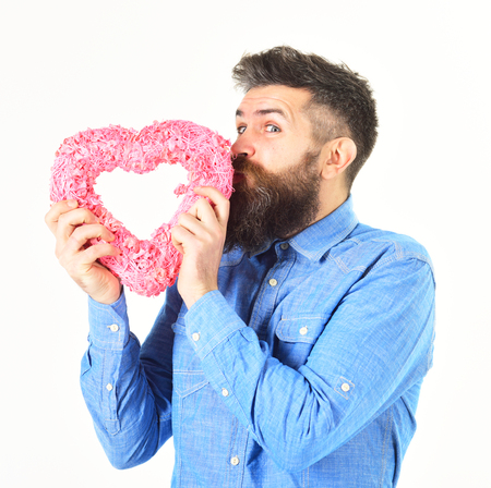 Mature man with long beard holds pink valentine heart. Stock Photo