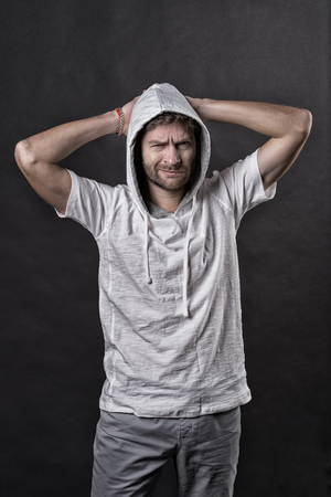 Bearded man frown in hood. Man with beard wear casual sweatshirt. Fashion model in hoodie tshirt. Active lifestyle and health activity. Fashion style and trend concept, vintage filter