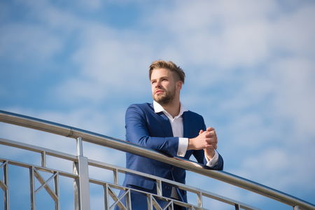 Businessman successful entrepreneur in suit walks outdoor sunny day, sky background. Businessman attractive appearance looks successful. Freedom concept. Man confident and well groomed enjoy freedom