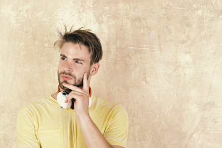 musical concept. listening to music on headphones. European guy have fun time. American handsome bearded guy with headphones. Blue eyed stylish hipster with smartphone. Stok Fotoğraf