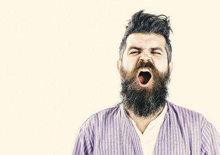 Man with yawning sleepy face on white background.