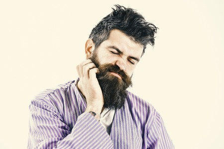 Man with itchy face wake up, scratching beard with hand. Фото со стока - 102862355