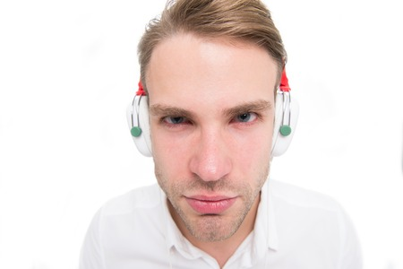 I can not hear you. Guy with earphones listens music. Man concentrated face listening favourite song in headphones. Man serious strict face busy listening music isolated white background Imagens - 102933586