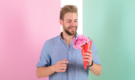 Best choice. Man ready for date bring pink flowers. Boyfriend smiling holds bouquet waiting for date. Macho holds bouquet as romantic gift. Guy bring romantic pleasant gift waiting for her Imagens