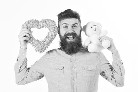 Bearded man holds symbols of love.
