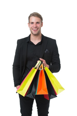 Set budget. People overspend on things because they had no parameters around spending. Shopping budget tip. Stop shopping once you hit limit. Set your budget. Man happy carries bunch of bags