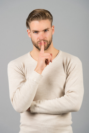 Keep silence. Man handsome attractive silence gesture. You better keep our secret. Being entrusted with secret can be both delight and burden. Guy asks to keep his secret Stock fotó
