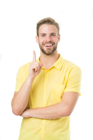 Have an idea. Bearded man smile with finger raised isolated on white. Happy macho in yellow tshirt with gesture. Business. Pay attention to this. Fresh idea. Casually handsome 版權商用圖片