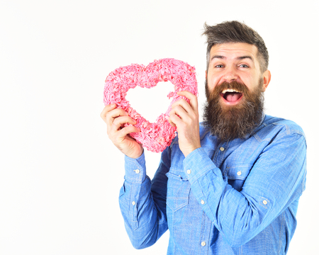 Portrait of handsome man with pink heart. Valentins day. Valentines concept. Man holding heart in his hands. Stock Photo
