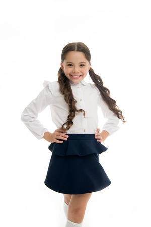 Happy schoolgirl. Hairstyle for schoolgirl nice and easy. Gorgeous tails perfect for every day of week. Cute everyday back to school hairstyles. Schoolgirl happy smiling pupil long curly hair Banque d'images - 103992174