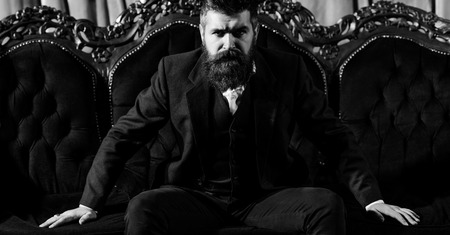 Bearded man in dressing with serious face