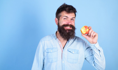 I love apples Man handsome hipster with long beard eating apple. Hipster hungry bites enjoy ripe apple.