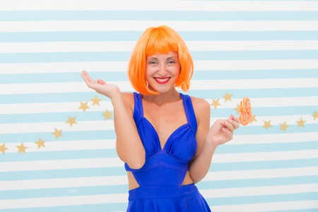 Crazy girl in playful mood. Cool girl with lollipop. Sexy woman. Fashion girl with orange hair having fun. happy pinup model with lollipop in hand. Sweet look. Going crazy. So much fun. Enjoy party. Banco de Imagens