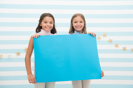Kids announcement concept. Amazing surprising news. Girl hold announcement banner. Girls kids holding paper banner for announcement. Children happy with blank paper announcement copy space.