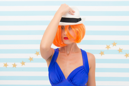Crazy girl in hat. fashion woman with orange hair. Glamour fashion model. Stylish girl with crazy look. Beauty and fashion. Woman dancer in hat. Ambitious and beautiful. Following her personal style. Imagens