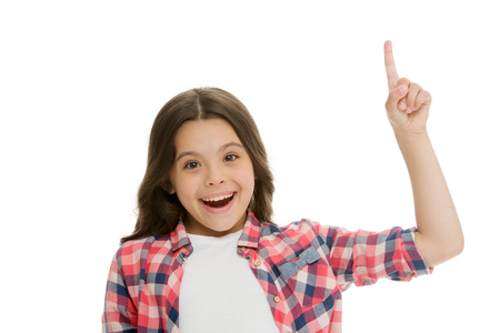 Kid point finger up isolated white. Child cute face brunette hair pointing upwards. Girl casual look recommend check this out. This direction. Subscribe or check. Push button turn on notification.