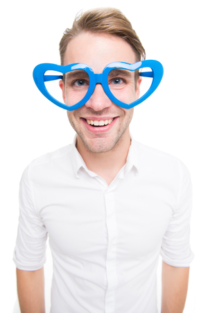 Funky and happy. Man happy smiling in valentines glasses. Handsome man wear heart shape glasses. Party goer. Happy valentines day party. Its party time. 스톡 콘텐츠