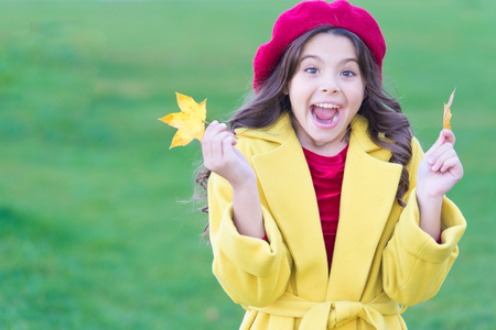Little girl excited about autumn season. Tips for turning autumn into best season. Kid girl smiling face hold maple leaves. Child with autumn maple leaves walk. Autumn coziness is just around.