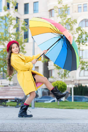 Stay positive fall season. Colorful fall accessory positive influence. Ways brighten your fall mood. Girl child long hair ready meet fall weather with umbrella. Colorful accessory for cheerful mood. Stok Fotoğraf