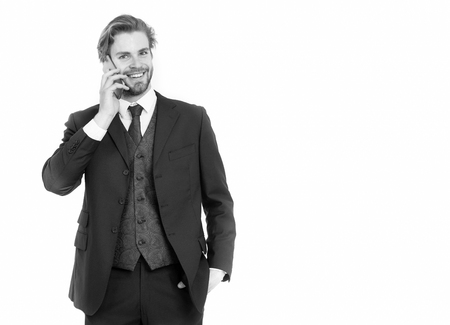 Businessman or ceo in black jacket. Man in formal outfit with mobile phone. Business fashion and success. Manager with beard on smiling face. Conversation and new technology., copy space Stockfoto