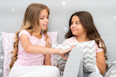 Best friends forever. Soulmates girls having fun bedroom interior. Childhood friendship concept. Girls best friends sleepover domestic party. Girlish leisure. Sleepover time for fun gossip story. Stock Photo