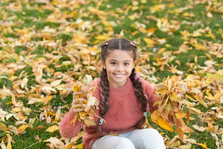 Autumn leaves and nature. Small child with autumn leaves. Happy childhood. School time. Happy little girl in autumn forest. So beautiful. Real relaxation. Autumn beauty. fashion. What a beauty. Imagens