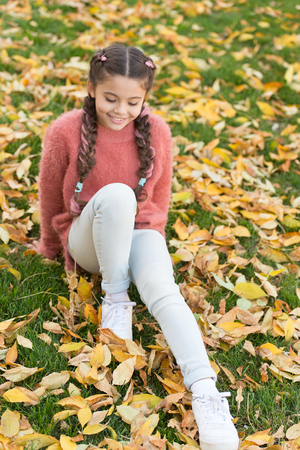 Autumn leaves and nature. Happy childhood. School time. Happy little girl in autumn forest. Perfect place to stay. Small child with autumn leaves. Feeling dry and protected. Ready for new adventures. Imagens