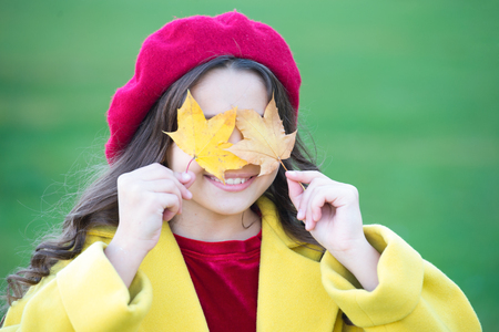 Joyfull and essentially happy. Small girl happy smiling with autumn leaves. Happy girl on autumn day. Small girl wear fashion clothing. Fashion trends for autumn. Fashionable and pretty.