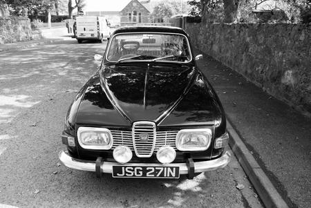Stornoway, United Kingdom - March 19, 2010: retro automobile on asphalt road.