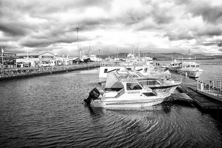 Reykjavik, Iceland - October 13, 2017: motor boats at sea pier in small village.