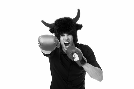 Man horns as devil or bull aggressive threaten violence gonna punch you.